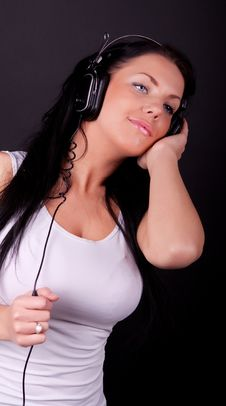 Woman Wearing T-shirt And Listening Royalty Free Stock Photo