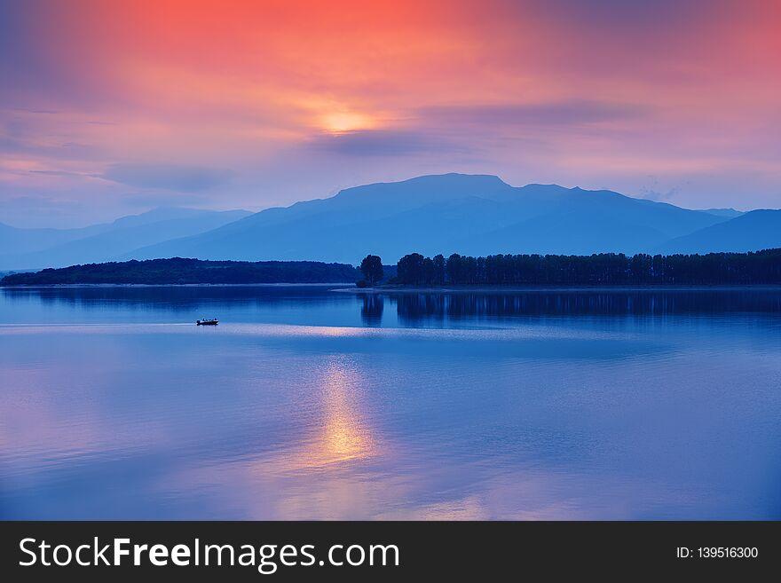 Beautiful sunset.Sun, lake.Sunset, sunrise landscape,panorama of beautiful nature. Blue Sky,amazing colorful clouds.Background.