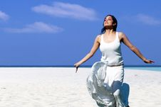 Free Woman On The Beach Stock Photo - 13960320