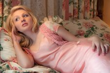 Pretty Blond Woman Lying On Pillows Royalty Free Stock Image