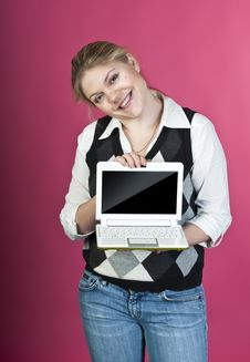 Blond Young Woman With Laptop Stock Images