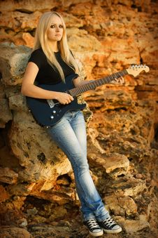 Free The Beautiful Blonde With A Guitar Stock Image - 13966491