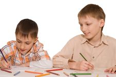 Brothers Sit At The Table And Draw Royalty Free Stock Photos
