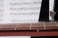 Free Closeup Guitar Neck, Notes And Metronome Royalty Free Stock Photos - 13969118