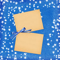Free Card For Design With Sheets And Blue Bow Royalty Free Stock Images - 13976619