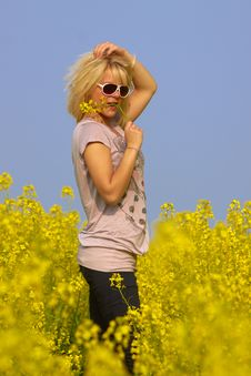 Free Blonde Sexy Girl In The Flower Rape Field Stock Photo - 13970280