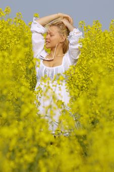 Free Blonde Sexy Girl In The Flower Rape Field Royalty Free Stock Photo - 13972395