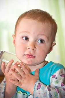 Young Baby Boy With Bottle Of Juice Stock Photography