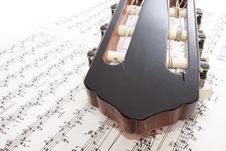 Free Closeup Guitar Headstock And Notes Stock Photo - 13974350