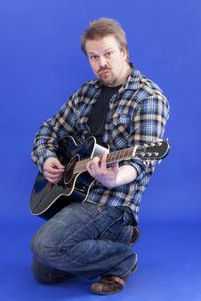 Free Man Plays Guitar Royalty Free Stock Photo - 13975235