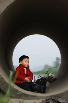 Free Cute Little Boy In Sewer Stock Photos - 13975253