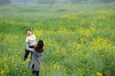 Free Mother And Son Play In Flowers Stock Photos - 13975753