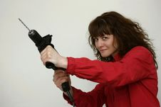 A Woman With A Drill Stock Images
