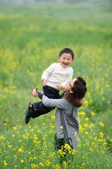 Free Mother And Son Love In Flowers Stock Photography - 13975982