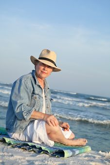 Mature Woman In Panama Hat At The Beach Stock Photos