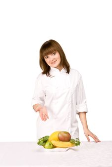 Free Girl Cook Shows Fruit Stock Photography - 13985872