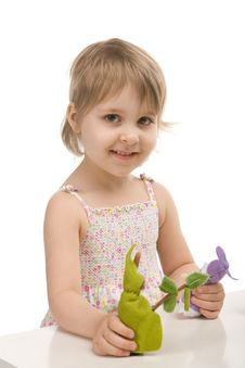 A Little Girl Plays With Gnomes Stock Photos