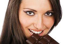 Free Portrait Of Young Smiling Woman Eating Chocolate Royalty Free Stock Photos - 13987018