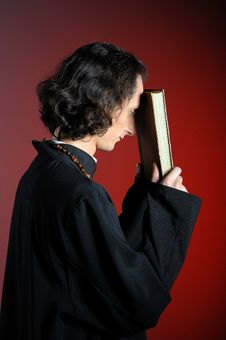 Praying Priest With Wooden Cross And Holy Bible Stock Images