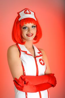 Free Young Sexy Nurse With Red Hair Royalty Free Stock Images - 13987469