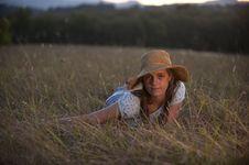 Free Cute Teen Girl Lying In Grass Stock Photography - 13988332