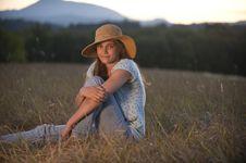 Teenage Girl Sitting In A Field Stock Image