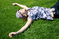 Free Young Girl Laying On The Grass Stock Image - 13991151