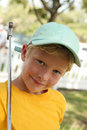 Free Boy Putt Putt Golf In Blue Cap - Clipping Path Royalty Free Stock Images - 13992839