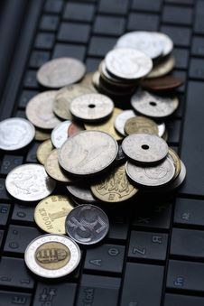 Free A Shot Of A Laptop And World Coins Stock Photo - 13990000