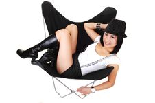 Asian Girl Lying In A Butterfly Chair. Royalty Free Stock Photos