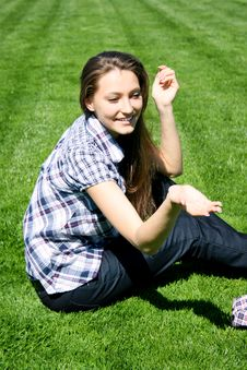 Free Happy Girl Sitting On The Green Grass Royalty Free Stock Images - 13991189