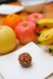 Contrast Of Fruits And Unhealthy Sweets Royalty Free Stock Image