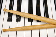 Drum Sticks On Piano Keyboard Royalty Free Stock Photo