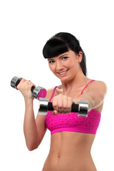 Girl With A Dumbbell Royalty Free Stock Photography