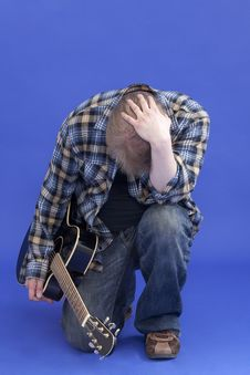 Free Portrait Of A Tired Guitarist Royalty Free Stock Images - 13994299