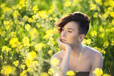 Pensive Girl On Field Stock Photo