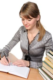Free Businesswoman With  Books On  Table Royalty Free Stock Image - 13995886