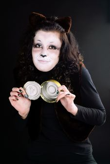 Cat-girl With Can. Royalty Free Stock Photos