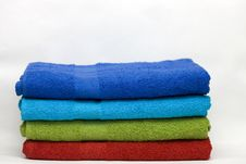 Free A Pile Of Clean Terry Towels Of Different Colors Royalty Free Stock Photography - 13999847