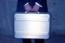 Free Businessman Holding Briefcase Royalty Free Stock Image - 1406016