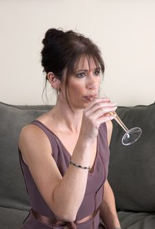 Woman Drinking Champagne On Couch Alone Royalty Free Stock Image