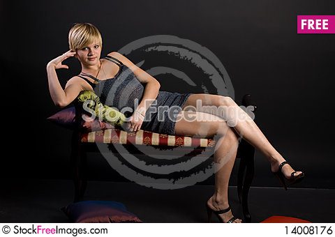 Free Girl Lying On The Couch Royalty Free Stock Image - 14008176