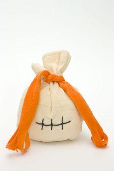 Free Gift In A Beautiful Orange Fabric Bag Royalty Free Stock Photo - 14000115