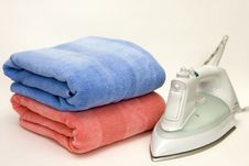Free Iron On A Pile Of Towels Stock Photography - 14000312