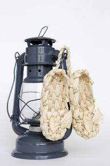 Free Kerosene Lamp And Sandals On The White Background Royalty Free Stock Photography - 14000337