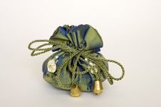 Free A Gift In A Beautiful Green Fabric Bag Royalty Free Stock Photography - 14000357