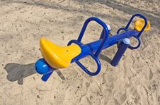Free An Empty Seesaw In A Playground Royalty Free Stock Images - 14001299