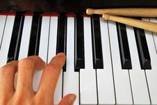 Free Left Hand Playing On Piano Keyboard Stock Image - 14003421