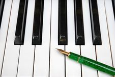 Fountain Pen On A Piano Keyboard Royalty Free Stock Photo