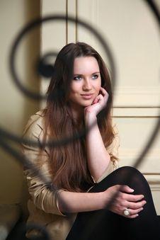 Free Beautiful Brunett Girl Sitting Behind Fence Royalty Free Stock Photos - 14005458